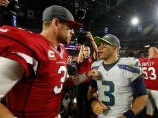 GLENDALE, AZ - JANUARY 03:  Quarterbacks Russell Wilson #3 of the Seattle Seahawks and Carson Palmer #3 of the Arizona Cardinals talk on the field following the NFL game at the University of Phoenix Stadium on January 3, 2016 in Glendale, Arizona. The Seahawks defeated the Cardinals 36-6.  (Photo by Christian Petersen/Getty Images)