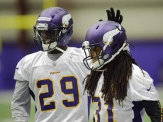 EDEN PRAIRIE, MN - MAY 03: Xavier Rhodes #29 and Bobby Felder #31 of the Minnesota Vikings look on during a rookie minicamp on May 3, 2013 at Winter Park in Eden Prairie, Minnesota. (Photo by Hannah Foslien/Getty Images)