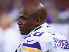 ST. LOUIS, MO - SEPTEMBER 7: Adrian Peterson #28 of the Minnesota Vikings looks on from the sideline during a game against the St. Louis Rams at the Edward Jones Dome on September 7, 2014 in St. Louis, Missouri.  The Vikings beat the Rams 34-6.  (Photo by Dilip Vishwanat/Getty Images)