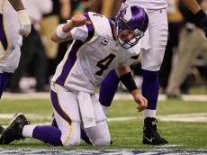 NEW ORLEANS - JANUARY 24:  Brett Favre #4 of  the Minnesota Vikings reacts after taking a hard hit in the second half against the New Orleans Saints during the NFC Championship Game at the Louisiana Superdome on January 24, 2010 in New Orleans, Louisiana.  (Photo by Jed Jacobsohn/Getty Images)