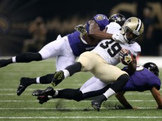 NEW ORLEANS, LA - AUGUST 28:   Travaris Cadet #39 of the New Orleans Saints is tackled by  Justin Tucker #9 of the Baltimore Ravens and  Sammy Seamster #37 of the Baltimore Ravens in their pre season game at the Mercedes-Benz Superdome on August 28, 2014 in New Orleans, Louisiana.  (Photo by Chris Graythen/Getty Images)