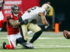ATLANTA, GA - SEPTEMBER 07:  William Moore #25 of the Atlanta Falcons forces Marques Colston #12 of the New Orleans Saints to fumble in overtime at the Georgia Dome on September 7, 2014 in Atlanta, Georgia.  The Falcons won 37-34.  (Photo by Kevin C. Cox/Getty Images)