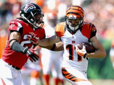 CINCINNATI, OH - SEPTEMBER 14:  Dane Sanzenbacher #11 of the Cincinnati Bengals runs with the ball while defended by Dwight Lowery #20 of the Atlanta Falcons during the game  at Paul Brown Stadium on September 14, 2014 in Cincinnati, Ohio.  (Photo by Andy Lyons/Getty Images)