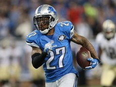 DETROIT, MI - OCTOBER 19:  Glover Quin #27 of the Detroit Lions runs back the fourth quarter interception off Dree Brees (not in photo) during the game at Ford Field on October 19, 2014 in Detroit, Michigan. The Lions defeated the Saints 24-23. (Photo by Leon Halip/Getty Images)