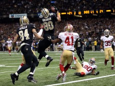 NEW ORLEANS, LA - NOVEMBER 09:  Jimmy Graham #80 of the New Orleans Saints catches a pass as time expires in front of Antoine Bethea #41 of the San Francisco 49ers at the Mercedes-Benz Superdome on November 9, 2014 in New Orleans, Louisiana.  The play was negated due to an offensive pass interference call on Jimmy Graham.  (Photo by Chris Graythen/Getty Images)