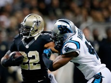 NEW ORLEANS, LA - DECEMBER 07:   Mark Ingram #22 of the New Orleans Saints carries the ball as  Roman Harper #41 of the Carolina Panthers defends during the first quarter at Mercedes-Benz Superdome on December 7, 2014 in New Orleans, Louisiana.  (Photo by Sean Gardner/Getty Images)