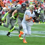 HONOLULU, HI - JANUARY 26: Drew Brees #9 of the New Orleans Saints and Team Rice is pressured by J. J. Watt #99 of the Houston Texans and Team Sanders during the 2014 Pro Bowl at Aloha Stadium on January 26, 2014 in Honolulu, Hawaii  (Photo by Scott Cunningham/Getty Images)
