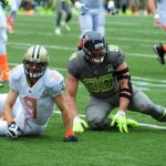 HONOLULU, HI - JANUARY 26: Drew Brees #9 of the New Orleans Saints and Team Rice is hit by J. J. Watt #99 of the Houston Texans and Team Sanders during the 2014 Pro Bowl at Aloha Stadium on January 26, 2014 in Honolulu, Hawaii  (Photo by Scott Cunningham/Getty Images)