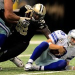 NEW ORLEANS, LA - NOVEMBER 10:  Tony Romo #9 of the Dallas Cowboys is sacked by Parys Haralson #98 of the New Orleans Saints during a game at the Mercedes-Benz Superdome on November 10, 2013 in New Orleans, Louisiana.  New Orleans won the game 49-17.  (Photo by Stacy Revere/Getty Images)