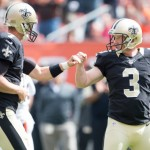 CLEVELAND, OH - SEPTEMBER 14: Quarterback Luke McCown #7 celebrates with kicker Shayne Graham #3 of the New Orleans Saints after a field goal during the game against the Cleveland Browns at FirstEnergy Stadium on September 14, 2014 in Cleveland, Ohio.  (Photo by Jason Miller/Getty Images)
