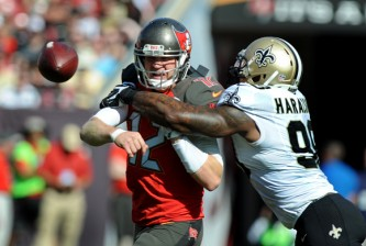 TAMPA, FL - DECEMBER 28: Quarterback Josh McCown #12 of the Tampa Bay Buccaneers throws the ball as he is hit by outside linebacker Parys Haralson #98 of the New Orleans Saints in the first quarter at Raymond James Stadium on December 28, 2014 in Tampa, Florida. (Photo by Cliff McBride/Getty Images) *** Local Caption ***Josh McCown;Parys Haralson