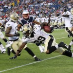 FOXBORO, MA - AUGUST 9:   Travaris Cadet #39 of the New Orleans Saints gains yardage during a game against the New England Patriots in the first half at Gillette Stadium on August 9, 2012 in Foxboro, Massachusetts. (Photo by Jim Rogash/Getty Images)