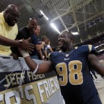 ST LOUIS, MO - SEPTEMBER 16:   Kendall Langford #98 of the St. Louis Rams is congratulated by fans after the game against the Washington Redskins at Edward Jones Dome on September 16, 2012 in St Louis, Missouri.  (Photo by Jamie Squire/Getty Images)