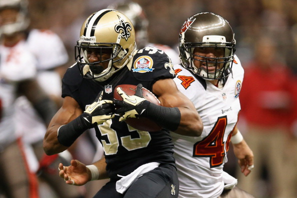 NEW ORLEANS, LA - DECEMBER 16:  Jabari Greer #33 of the New Orleans Saints intercepts a ball inteded for  Dallas Clark #44 of the Tampa Bay Buccaneers at the Mercedes-Benz Superdome on December 16, 2012 in New Orleans, Louisiana.  (Photo by Chris Graythen/Getty Images)