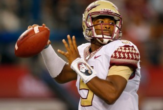 ARLINGTON, TX - AUGUST 30:  Jameis Winston #5 of the Florida State Seminoles passes against the Oklahoma State Cowboys in the first half of the Advocare Cowboys Classic at AT&T Stadium on August 30, 2014 in Arlington, Texas.  (Photo by Tom Pennington/Getty Images)