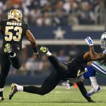 ARLINGTON, TX - SEPTEMBER 28:  Lance Dunbar #25 of the Dallas Cowboys is hit by Jairus Byrd #31 of the New Orleans Saints as Ramon Humber #53 of the Saints follows the play in the first half at AT&T Stadium on September 28, 2014 in Arlington, Texas.  (Photo by Ronald Martinez/Getty Images)