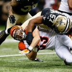 NEW ORLEANS, LA - NOVEMBER 16:  Rex Burkhead #33 of the Cincinnati Bengals dives for more yardage against  David Hawthorne #57 of the New Orleans Saints during the first quarter at Mercedes-Benz Superdome on November 16, 2014 in New Orleans, Louisiana.  (Photo by Kevin C. Cox/Getty Images)