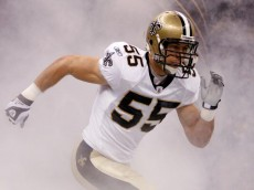 NEW ORLEANS - OCTOBER 18:  Scott Fujita #55 of the New Orleans Saints runs onto the field after being introduced prior to playing the New York Giants at the Louisiana Superdome on October 18, 2009 in New Orleans, Louisiana.  (Photo by Chris Graythen/Getty Images)