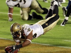 MIAMI GARDENS, FL - FEBRUARY 07:  Pierre Thomas #23 of the New Orleans Saints leaps into the end zone to score a touchdown against of the Indianapolis Colts in the third quarter during Super Bowl XLIV on February 7, 2010 at Sun Life Stadium in Miami Gardens, Florida.  (Photo by Elsa/Getty Images)