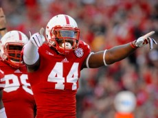 LINCOLN, NE - NOVEMBER 16: Defensive end Randy Gregory #44 of the Nebraska Cornhuskers reacts after a tackle during their game at against the Michigan State Spartans Memorial Stadium on November 16, 2013 in Lincoln, Nebraska. (Photo by Eric Francis/Getty Images)