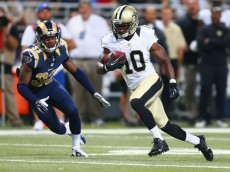 ST. LOUIS, MO - AUGUST 8: Brandin Cooks #10 of the New Orleans Saints runs upfield after making a catch against E.J. Gaines #33 of the St. Louis Rams during the second half of a pre-season game at the Edward Jones Dome on August 8, 2013 in St. Louis, Missouri.  The Saints beat the Rams 26-24.  (Photo by Dilip Vishwanat/Getty Images)