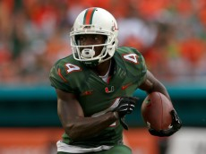 MIAMI, FL - SEPTEMBER 13: Phillip Dorsett #4 of the Miami Hurricanes rushes during a game against the Arkansas State Red Wolves at Sunlife Stadium on September 13, 2014 in Miami, Florida.  (Photo by Mike Ehrmann/Getty Images)