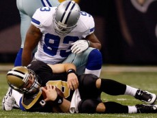 NEW ORLEANS - DECEMBER 19:  Drew Brees #9 of the New Orleans Saints is sacked by Spencer Anthony #92 of the Dallas Cowboys at the Louisiana Superdome on December 19, 2009 in New Orleans, Louisiana.  (Photo by Chris Graythen/Getty Images)