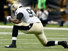NEW ORLEANS, LA - AUGUST 15:  Junior Galette #93 of the New Orleans Saints celebrates after a tackle during a preseason game against the Tennessee Titans at the Mercedes-Benz Superdome on August 15, 2014 in New Orleans, Louisiana.  (Photo by Stacy Revere/Getty Images)