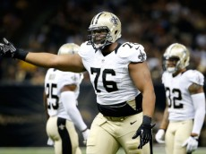 NEW ORLEANS, LA - AUGUST 15:  Akiem Hicks #76 of the New Orleans Saints reacts to a call during a preseason game against the Tennessee Titans at the Mercedes-Benz Superdome on August 15, 2014 in New Orleans, Louisiana.  (Photo by Stacy Revere/Getty Images)