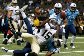 NEW ORLEANS, LA - AUGUST 15:  Seantavius Jones #15 of the New Orleans Saints catches a pass for a touchdown as Micah Pellerin #32 of the Tennessee Titans defends during a preseason game between the New Orleans Saints and the Tennessee Titans at Mercedes-Benz Superdome on August 15, 2014 in New Orleans, Louisiana.  (Photo by Sean Gardner/Getty Images)