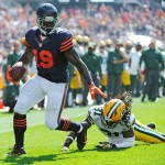 CHICAGO, IL- SEPTEMBER 28: Josh Morgan #19 of the Chicago Bears avoids a tackle by Davon House #31 of the Green Bay Packers during the first quarter on September 28, 2014 at Soldier Field in Chicago, Illinois.  (Photo by David Banks/Getty Images)
