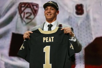 CHICAGO, IL - APRIL 30:  Andrus Peat of the Stanford Cardinal football team holds up a jersey after being picked #13 by the New Orleans Saints during the first round of the 2015 NFL Draft at the Auditorium Theatre of Roosevelt University on April 30, 2015 in Chicago, Illinois.  (Photo by Jonathan Daniel/Getty Images)