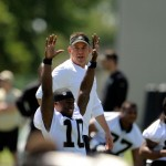 METAIRIE, LA - MAY 17:  Head coach Sean Payton walks behind Brandin Cooks #10 during the New Orleans Saints Rookie Minicamp at the Saints training facility on May 17, 2014 in Metairie, Louisiana.  (Photo by Stacy Revere/Getty Images)