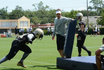(Dennis Allen runs tackling drills with the Saints secondary)