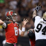 NEW ORLEANS, LA - OCTOBER 05:  Mike Glennon #8 of the Tampa Bay Buccaneers is pressured by Cameron Jordan #94 of the New Orleans Saints during the first quarter of a game at the Mercedes-Benz Superdome on October 5, 2014 in New Orleans, Louisiana.  (Photo by Chris Graythen/Getty Images)