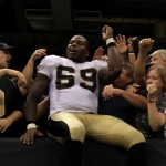 NEW ORLEANS - SEPTEMBER 09:  Anthony Hargrove #69 of the New Orleans Saints celebrates with fans in the stands after the Saints won 14-9 against the Minnesota Vikings at Louisiana Superdome on September 9, 2010 in New Orleans, Louisiana.  (Photo by Ronald Martinez/Getty Images)