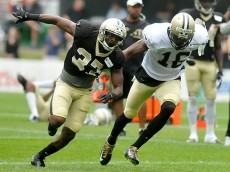 """""""Defensive back Terrence Frederick and receiver Brandon Coleman battle through special teams drills during Saints training camp July 27 in White Sulphur Springs. Brad Davis/The Register-Herald"""""""