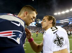 FOXBORO, MA - OCTOBER 13:   Tom Brady #12 of the New England Patriots and  Drew Brees #9 of the New Orleans Saints talk after the game at Gillette Stadium on October 13, 2013 in Foxboro, Massachusetts.The New England Patriots defeated the New Orleans Saints 30-27.  (Photo by Elsa/Getty Images)