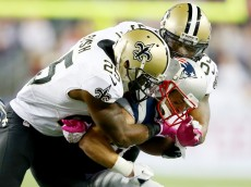 FOXBORO, MA - OCTOBER 13:   Danny Amendola #80 of the New England Patriots is hit by  Rafael Bush #25 and  Keyunta Dawson #55 of the New Orleans Saints at Gillette Stadium on October 13, 2013 in Foxboro, Massachusetts.The New England Patriots defeated the New Orleans Saints 30-27. Amendola left the game after this play.(Photo by Elsa/Getty Images)