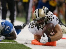 DETROIT, MI - OCTOBER 19: Austin Johnson #35 of the New Orleans Saints dives for a second-quarter touchdown against the Detroit Lions at Ford Field on October 19, 2014 in Detroit, Michigan. (Photo by Greg Shamus/Getty Images)