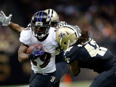 NEW ORLEANS, LA - NOVEMBER 24:  Justin Forsett #29 of the Baltimore Ravens is pursued by Keenan Lewis #28 and Pierre Warren #42 of the New Orleans Saints during the second quarter of a game at the Mercedes-Benz Superdome on November 24, 2014 in New Orleans, Louisiana.  (Photo by Wesley Hitt/Getty Images)