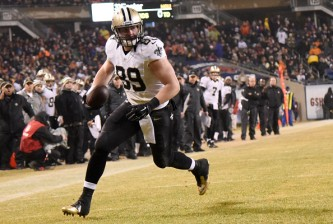 CHICAGO, IL - DECEMBER 15: Josh Hill #89 of the New Orleans Saints runs in a touchdown during the third quarter of their game against the Chicago Bears at Soldier Field on December 15, 2014 in Chicago, Illinois. (Photo by David Banks/Getty Images)