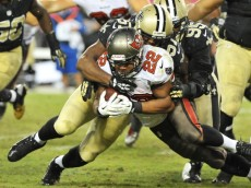 TAMPA, FL - SEPTEMBER 15: Running back Doug Martin #22 of the Tampa Bay Buccaneers runs for a gain against the New Orleans Saints September 15, 2013 at Raymond James Stadium in Tampa, Florida. The Saints won 16 - 14. (Photo by Al Messerschmidt/Getty Images)