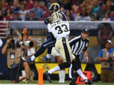 ST. LOUIS, MO - AUGUST 8: Stedman Bailey #12 of the St. Louis Rams makes a touchdown catch against Stan Jean-Baptiste #33 of the New Orleans Saints during the first half of a pre-season game at the Edward Jones Dome on August 8, 2013 in St. Louis, Missouri.  (Photo by Dilip Vishwanat/Getty Images)