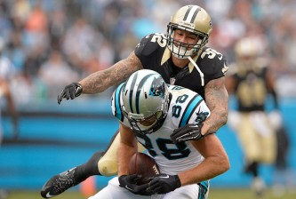 CHARLOTTE, NC - SEPTEMBER 27:  Greg Olsen #88 of the Carolina Panthers makes a catch against Kenny Vaccaro #32 of the New Orleans Saints during their game at Bank of America Stadium on September 27, 2015 in Charlotte, North Carolina.  (Photo by Grant Halverson/Getty Images)