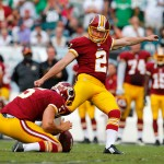 PHILADELPHIA, PA - SEPTEMBER 21:  Kai Forbath #2 of the Washington Redskins attempts a field goal as Tress Way #5 holds in the fourth quarter against the Philadelphia Eagles at Lincoln Financial Field on September 21, 2014 in Philadelphia, Pennsylvania.  (Photo by Rich Schultz/Getty Images)