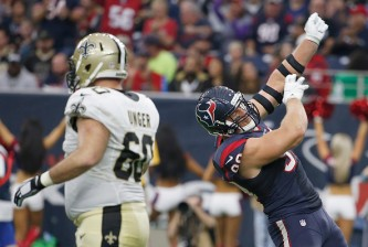 HOUSTON, TX - NOVEMBER 29: J.J. Watt #99 of the Houston Texans reacts after making a defensive play against the New Orleans Saints in the third quarter on November 29, 2015 at NRG Stadium in Houston, Texas. (Photo by Scott Halleran/Getty Images)