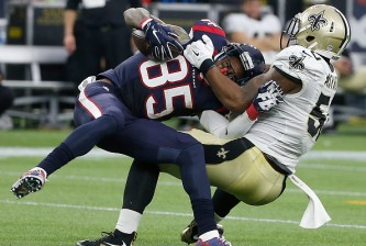 HOUSTON, TX - NOVEMBER 29: Nate Washington #85 of the Houston Texans is tackled by Stephone Anthony #50 of the New Orleans Saints in the fourth quarter on November 29, 2015 at NRG Stadium in Houston, Texas. (Photo by Bob Levey/Getty Images)