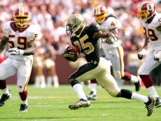 LANDOVER, MD - SEPTEMBER 14:  Reggie Bush #25 of the New Orleans Saints attempts to elude London Fletcher #59 of the Washington Redskins at FedEx Field September 14, 2008 in Landover, Maryland.  (Photo by Matthew Stockman/Getty Images)