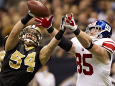 NEW ORLEANS, LA - NOVEMBER 28:   Will Herring #54 of the New Orleans Saints intercepts a pass in the end zone thrown to Jake Ballard #85 of the New York Giants at Mercedes-Benz Superdome on November 28, 2011 in New Orleans, Louisiana.  (Photo by Wesley Hitt/Getty Images)